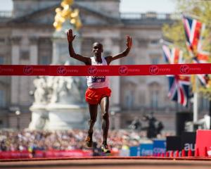 Eliud Kipchoge crosses the finish line at the London Marathon. Photo: Getty Images