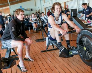 Otago Boys' High School rower Oliver Haig digs in, encouraged by his brother Chris, while...