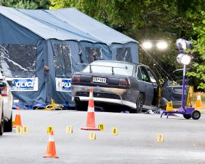 Police investigation scene after a shoot out between police and an offender in a residential...
