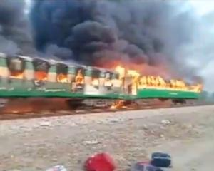 Video grab of a fire burning in a train carriage after a gas canister passengers were using to...