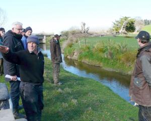Lovells Flat sheep farmer Bryce Clark shows neighbouring farmers areas of successful on-farm...