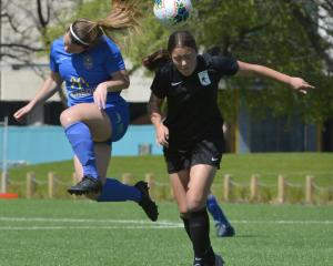 Southern United midfielder Chelsea Whittaker (left) seeks to head the ball in front of Capital's...