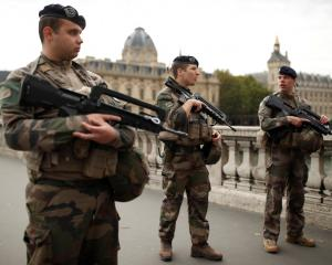 Security personnel is seen after an attack on the police headquarters in Paris. Photo: Reuters