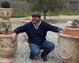 Yannick Fourbet with some of his French-made pots with their antique glaze outside his Lowburn...