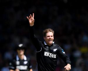 Pace bowler Lockie Ferguson celebrates the wicket of David Warner during the Cricket World Cup...
