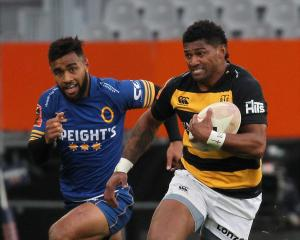 Waisake Naholo, playing for Taranaki against Otago last month, runs hard at Forsyth Barr Stadium,...