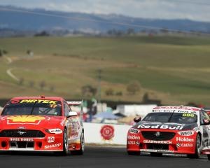 Scott McLaughlin driving the #17 Shell V-Power Racing Ford is chased by Jamie Whincup driving the...