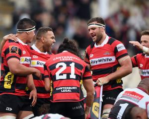 Relieved Canterbury players celebrate their late win over North Harbour. Photo: Getty Images