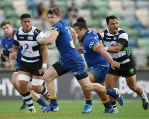 Otago fullback Michael Collins had a barnstorming first-half, crossing the line twice. Photo:...