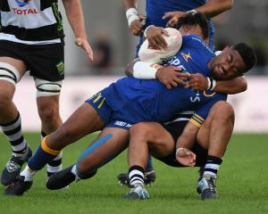 Otago's Vilimoni Koroi is hauled to the ground during the Mitre 10 Cup Championship semifinal...
