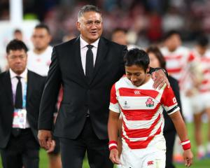 Coach Jamie Joseph with Japan player Yutaka Nagare following their loss to South Africa. Photo:...