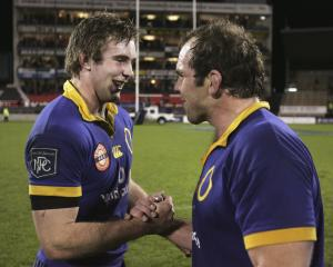 Otago's Matt Saunders (left) and Anton Oliver celebrate beating Canterbury 37-22 in an NPC...