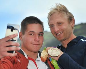 St Petersburg State University rower Egor Lubskii takes a selfie with Hamish Bond at the...