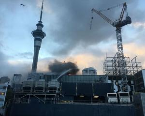 Crews continue to battle the fire this morning. Photoo: NZ Herald
