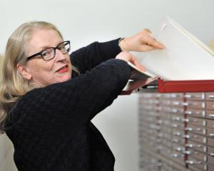 Hocken Library archives head curator Anna Blackman peruses the Salmond Architects Collection....