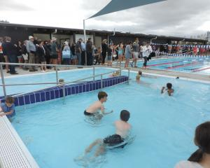 Youngsters enjoy a swim in the new Waiau pool on its official opening day in February. The pool...