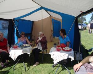 Adriel residents and staff enjoy a chat in the shade at last year's Amberley A&P Show. Photo:...