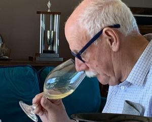 Judging team chairman Jim Harre samples a wine during the challenge. Photos: Supplied