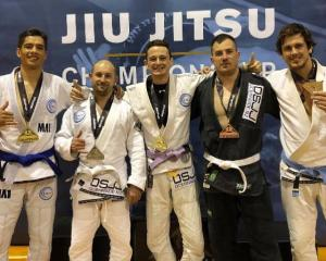 South New Brighton's Oceanside Jiu-jitsu Club members Kris Carson, left, Max Mills, Hayden Smith,...