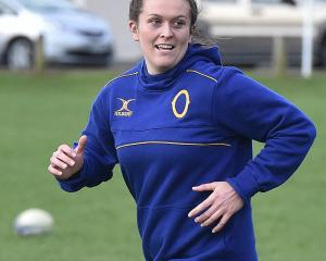 Otago lock Julia Gorinski exchanges a light moment with a team-mate during a training session at...