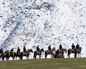 Riders line a ridge near the film set in the Ahuriri Valley. Photo: Stephen Jaquiery