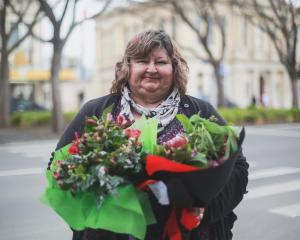 North Otago Floral Art Group president Colleen Waby gets ready to deliver flowers in Oamaru as...