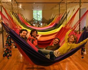 OPAVIVARA! members play in their hammocks at the Dunedin Public Art Gallery. Photo: Linda Robertson