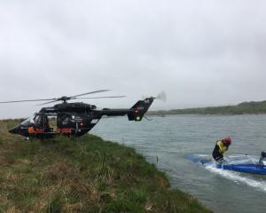 Rescue helicopter and search and rescue crew search the Waitaki River near Duntroon yesterday ...