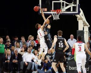 RJ Hampton blocks LaMelo Ball during the Breakers win over the Hawks last night. Photo: Getty Images