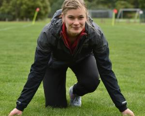 Rosie Elliott (21) prepares for a training session at the Caledonian Ground yesterday after...