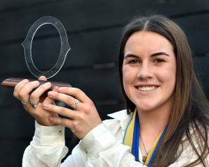 Rosie Kelly, judged Otago Spirit's most valuable player, holds the spoils of a brilliant season...