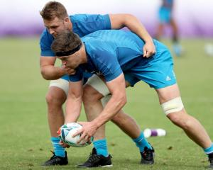 Sam Cane (left) could be replaced by Scott Barrett (with ball) in the All Blacks starting line-up...