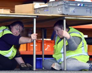 Cargill Enterprises workers Nicola Ralston (left) and Lorraine Tecofsky take part in ShakeOut,...
