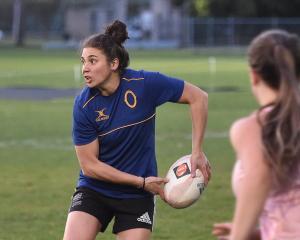 Otago fullback Sheree Hume passes the ball at training at Logan Park on Thursday night. PHOTO:...