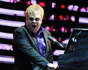 Sir Elton John belts out a hit in Dunedin's Forsyth Barr Stadium last night. Photo by Craig Baxter.