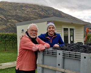 Not-quite-retired grower and winemaker Alan Brady (left), of Clyde, and Irish winemaking intern...