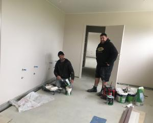 Michael Beer (left) and Nathan Kitto, of Southern Decorating, bring colour to the walls in the...
