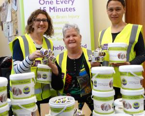 Taking to the streets . . . Preparing for tomorrow's Brain Injury Otago street day appeal are ...