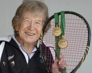 Jean Stevens shows off her two 85-and-over tennis world championship medals at the St Clair...