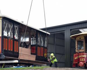 Restored Dunedin cable cars, such as Roslyn No95, could be used for passenger transport in the...