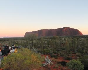View from the sunrise platform . . . crowds waiting for the sun to hit Uluru with Kata Tjuta (the...