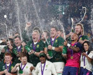 The South African team celebrate their victory in the World Cup final. Photo: Reuters
