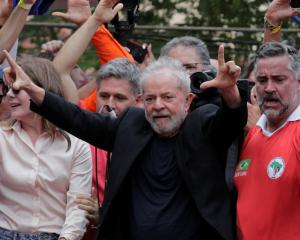 Former Brazilian President Luiz Inacio Lula da Silva arrives to deliver a speech after being...