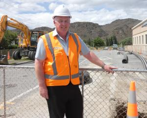 Central Otago District Council senior project engineer Kevin Furnival checks out progress on the...