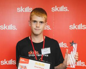James Avenell shows his Top Junior Bright Spark award at Datacom in Auckland. PHOTO: SUPPLIED
