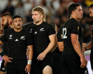 Richie Mo'unga, Jack Goodhue and Anton Lienert-Brown react after the All Blacks loss to England....