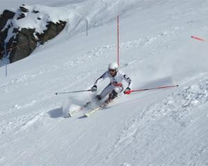 American skier Troy Cohee enjoys the top skiing conditions as he competes in the FIS men's slalom...
