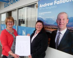Ashburton College teacher aide Cezarne Rodgers hands over the open letter to Rangitata electorate...