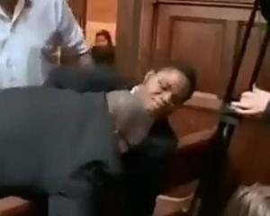 Ebenezer Azamati is pulled from his chair by security guards during a debate at the Oxford Union....
