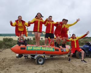 Celebrating their club's win in the BP Vote the Boat competition for a new IRB yesterday are ...